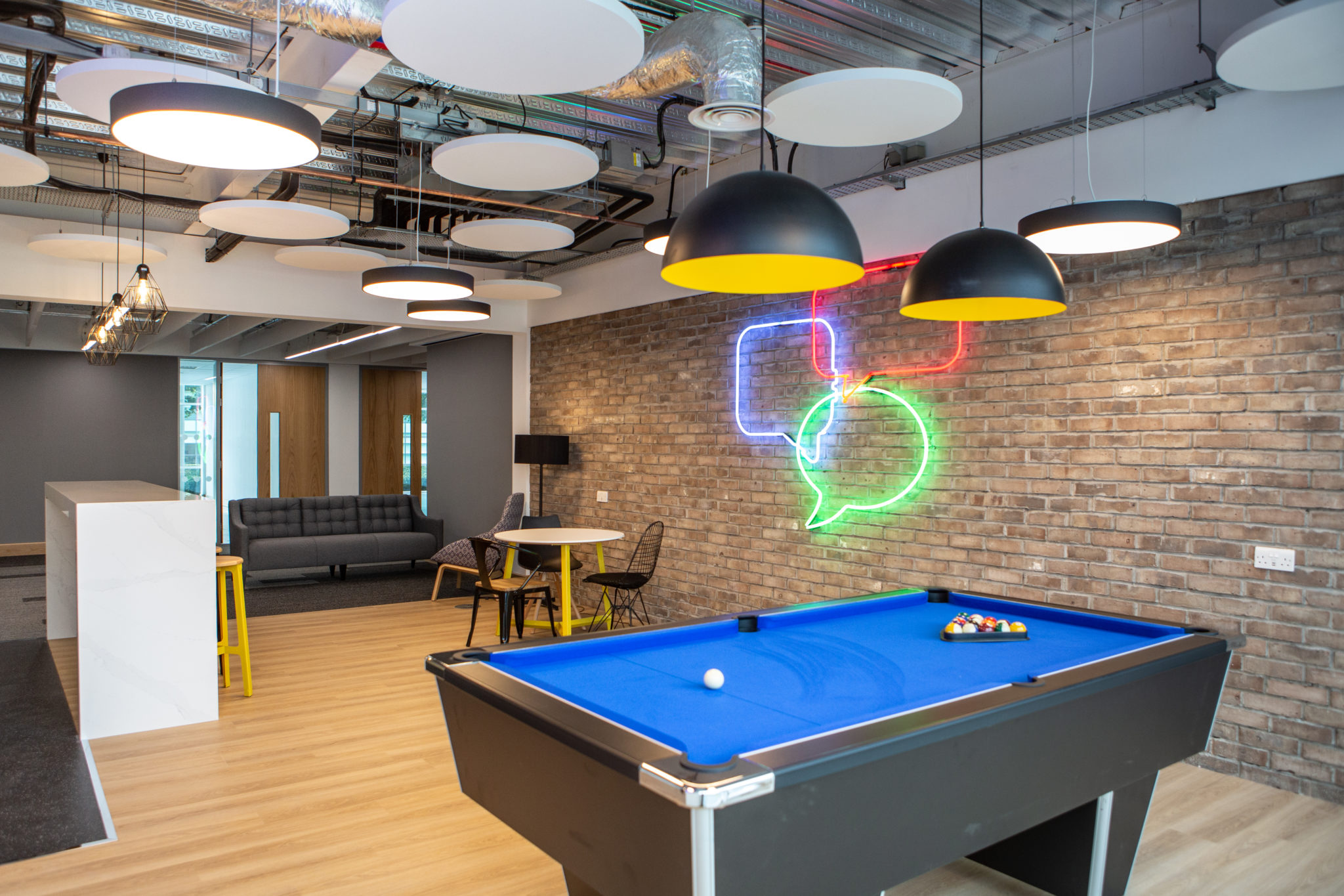 Pool table inside the Neon building office space